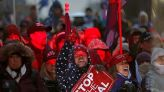 FILE PHOTO: Supporters of U.S. President Donald Trump gather at a rally at Freedom Plaza in Washington