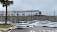 Starbucks Sign Toppled, Buildings Damaged in Galveston by Storm Nicholas