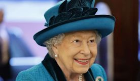 Queen Elizabeth Is All Smiles Amid Family Drama as She Views Stamps — of Herself!