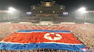 No nuclear weapons but hazmat suits on parade as North Korea celebrates 73rd anniversary