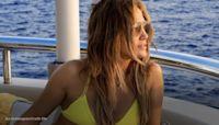 Jennifer Lopez wears tiny yellow bikini while vacationing on yacht