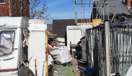Father and son fined over 'rat-ridden waste mountain' outside their home