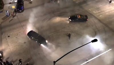 SEE IT: Cars doing donuts hit several people near Seattle's Space Needle