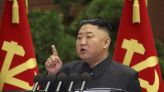Kim Jong Un photographed with mystery spot, bandage on head