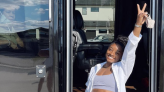 Simone Biles Flashes Her Six-Pack Abs (And A Peace Sign) On The Road