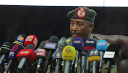 Sudan general says PM is 'at my home' after coup