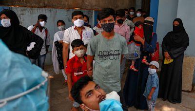 India's capital to lock down amid explosive virus surge
