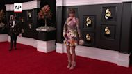 Taylor Swift, Harry Styles hit Grammys red carpet