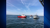 5 rescued when boat overturns in Buzzards Bay