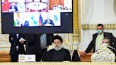 Iran denounces 'unilateralism' as it becomes full SCO member