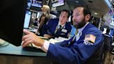 Dow surges 338 points as Federal Reserve hints at pace of tapering and timing of rate hikes