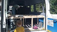 Mum ditches the daily grind to 'roadschool' her children in their very own classroom camper van