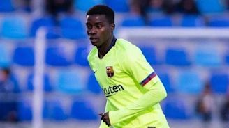 Barcelona defender Moussa Wague apologises for striking fan after 'numerous racist insults'