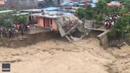 Building Collapses Into Raging Floodwater in Dili, East Timor