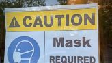 Walmart and others require employees to mask up again