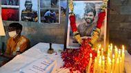 Slain Reuters journalist is buried in his hometown