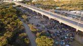 Mexican forces surround border migrant camp