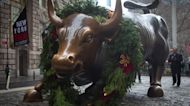 Dow, S&P end wild year at record highs