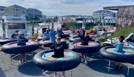 Maryland seafood bar using giant inner tubes on wheels for patrons to socially distance