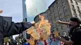 Donald Trump cutout set on fire, two arrested at dueling Boston protests