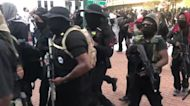 Black Paramilitary Group Marches Through Downtown Lafayette