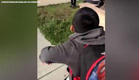 School friends caught on camera greeting each other with adorable dance in California