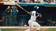 Passage: Baseball great Hank Aaron