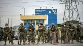 Ecuador raises death toll from prison riots to 79; police chief warns of new riot