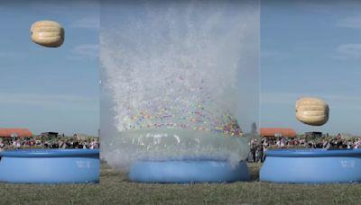Watch a 1,200 Pound Pumpkin Drop 100 Feet Into a Pool