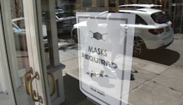 Masks return to Bay Area businesses with little notice, mixed reaction