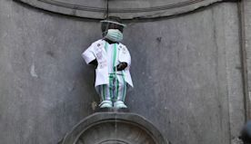 Belgium's peeing statue dressed to honor health workers