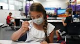 As COVID-19 rates dip, some parents demand that masks be optional for students next fall