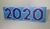 This local YouTube star built a display of 3,000 dominoes that says '2020' — and soon you can watch her topple it - The Boston Globe