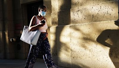 CDC is considering revising its outdoor mask guidance. Here's what health experts say.