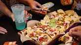 You Can Get Half Off Taco Bell's Nacho Party Pack And Free Delivery With DoorDash Starting Today
