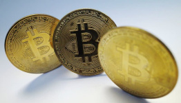 Bitcoin sits below all-time high after U.S. ETF debut