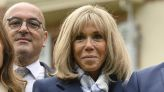 French First Lady Brigitte Macron Elevates Classic Navy Suiting With Graphic Louis Vuitton Ankle Boots