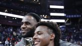 LeBron James watches son Bronny open framed photo of his first 'Sports Illustrated' cover