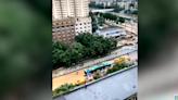 視頻:鄭州京廣隧道 被拖出的公交車引質疑