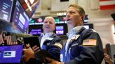 Stock futures are flat after Dow and S&P 500 close at records, big tech earnings on deck