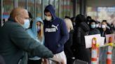 'Still in the surge': Virus keeps a hold on Massachusetts