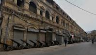 The Latest: Pakistan locks down Karachi amid new surge