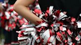 Cheerleaders apologize after harassing rivals with 'privilege' sign