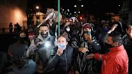 Colombians revel, protest over order to detain ex-President Uribe