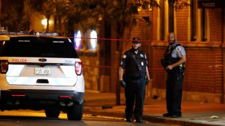 Fourteen people injured in shootout at Chicago funeral