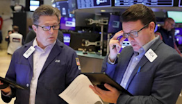 S&P 500 edges higher after bumpy week, Nike drags