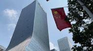China real estate company Evergrande Group narrowly avoids default