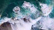 Waves Crash Over Ocean Rockpool in Sydney, Australia