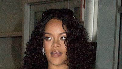 Rihanna Makes a Bold Statement in a Graphic T-Shirt and Neutral-Colored Satin Boots in NYC