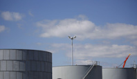 Oil Climbs as U.S. Supplies Tumble in Peak Demand Season